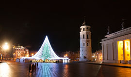 Christmas Tree in Vilnius Cathedral Square, Lithuania. The photo shows the Cathedral bell-tower, the Cathedral building and Cathedral square. The Christmas Tree Royalty Free Stock Photography