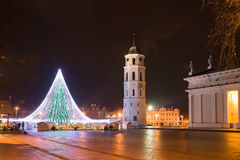 Christmas Tree in Vilnius Cathedral Square. The photo shows the Cathedral bell-tower,the Cathedral building and Cathedral square. The Christmas Tree made of Stock Photos