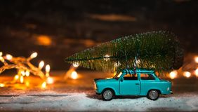 Christmas tree on vintage toy car. Christmas concept royalty free stock photo