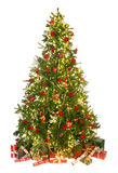 Christmas tree on white. Beautiful christmas tree isolated on white with gifts and ornaments Royalty Free Stock Image
