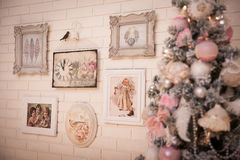 Christmas tree at the white brick wall background. Royalty Free Stock Photography
