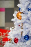 Christmas tree white and green colour and new year decoration in the department store. Christmas tree white and green colour  and new year decoration in the royalty free stock image
