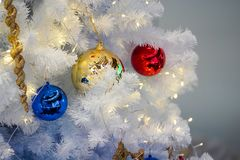 Christmas tree white and green colour and new year decoration in the department store. Christmas  tree white and green colour and new year decoration in the royalty free stock photography