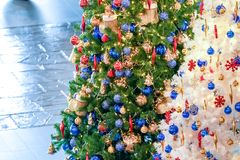 Christmas tree white and green colour and new year decoration in the department store. Christmas  tree white and green colour and new year decoration in the royalty free stock images