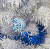 Christmas tree with white lights and ball painted in the style of Gzhel Royalty Free Stock Photo