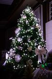 Christmas tree with white lights royalty free stock photo