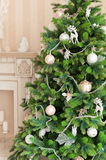 Christmas tree with white ornaments in vintage interior Royalty Free Stock Photo
