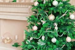 Christmas tree with white ornaments in vintage interior Royalty Free Stock Photography