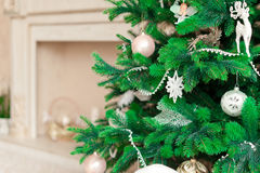 Christmas tree with white ornaments in vintage interior Royalty Free Stock Images