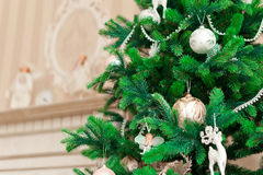 Christmas tree with white ornaments in vintage interior Stock Image