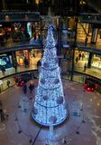 Christmas tree. White shining christmas tree located in shopping mall stock images