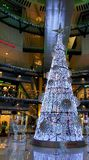 Christmas tree. White shining christmas tree located in shopping mall stock image