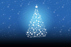Christmas tree with white snowflakes. On the background of blue snowflakes Royalty Free Stock Photo