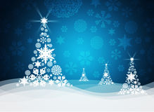 Christmas tree from white snowflakes. On blue background Stock Image