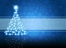 Christmas tree from white snowflakes. On blue background Royalty Free Stock Photography