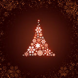 Christmas tree from white snowflakes. On dark red background Royalty Free Stock Images