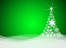 Christmas tree from white snowflakes. On green background Royalty Free Stock Photo
