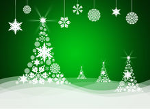 Christmas tree from white snowflakes. On green background Royalty Free Stock Image
