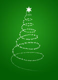 Christmas tree from white snowflakes. On green background Stock Photography
