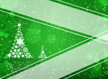 Christmas tree from white snowflakes. On green background Stock Image