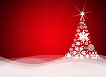 Christmas tree from white snowflakes. On red background Stock Image