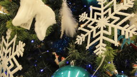 Christmas tree with white toys and decorations background. Close-up. In the hypermarket. stock video