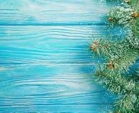 Christmas tree winter branch season on blue wooden background, snow. Christmas tree branch winter blue wooden background, snow season royalty free stock images