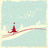 Christmas tree in winter landscape Royalty Free Stock Photos