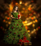 Christmas Tree Woman Fashion Dress, Model Girl, Xmas Lights. Christmas Tree Woman Fashion Dress, Model Girl and Candle, Present Gift on Xmas Red Lights Stock Images
