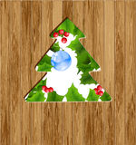 Christmas tree on a wooden background Royalty Free Stock Photography