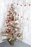 Christmas tree on wooden background. Decorated Christmas tree holiday symbol Stock Photography