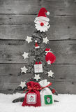 Christmas tree on wooden background - greeting card. Royalty Free Stock Photo