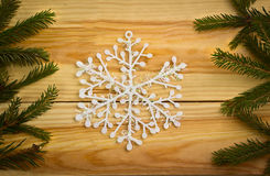 Christmas tree on wooden background with snowflake Royalty Free Stock Photos