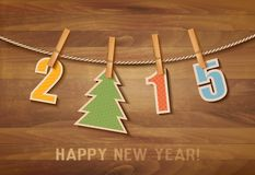 2015 with a christmas tree on wooden background. Vector Stock Photos