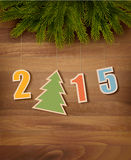 2015 with a Christmas tree on wooden background. Stock Photography