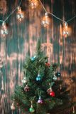 Christmas tree on a wooden blurred background stock photo