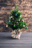 Christmas tree on a wooden blurred background royalty free stock photos