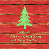 Christmas tree on a wooden boards. Christmas and New Year greeting card. Illustration with Christmas tree on a wooden boards background Royalty Free Stock Photos