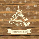 Christmas tree on a wooden boards. Christmas and New Year greeting card. Illustration with Christmas tree and snowflakes on a wooden boards background Royalty Free Stock Photo