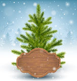Christmas Tree with Wooden Frame in Snow on Wooden Floor on Blue Royalty Free Stock Images