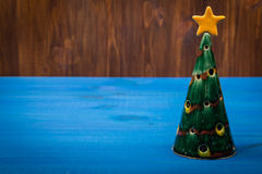 Christmas tree on wooden planks Stock Images