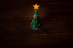Christmas tree on wooden planks Royalty Free Stock Photo