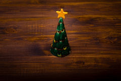 Christmas tree on wooden planks Stock Image