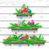 Christmas tree of wooden shelves. Christmas tree of three wood shelves showcases with shadow on white wooden panel wall background. Advertising holiday plank Stock Photos