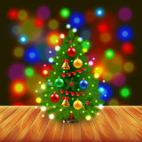 Christmas tree on wooden table Stock Photo