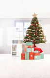 Christmas tree and wrapped gifts Stock Photo