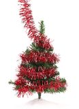 Christmas tree wrapped in tinsel. Stock Images