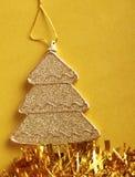 Christmas tree,  on yellow bacground. Stock Photo