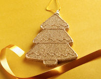 Christmas tree,  on yellow bacground. Royalty Free Stock Photo