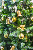 Christmas tree with yellow shiny toys Stock Photo